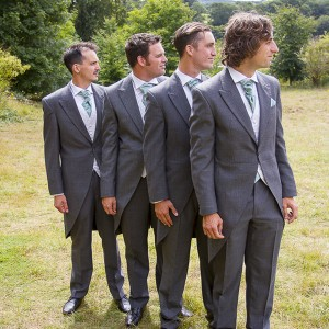 Groom and best man and ushers looking right