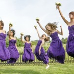 Wedding bridesmaids jumping. Flower and hair in the air!