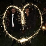 couple making heart shape in the air with sparklers