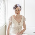 Bride sitting by bright window
